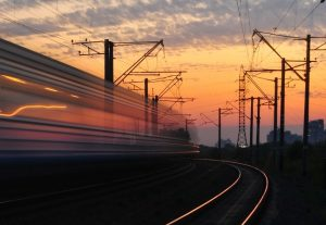 rail-road-under-gray-and-orange-cloudy-sky-during-sunset-163856